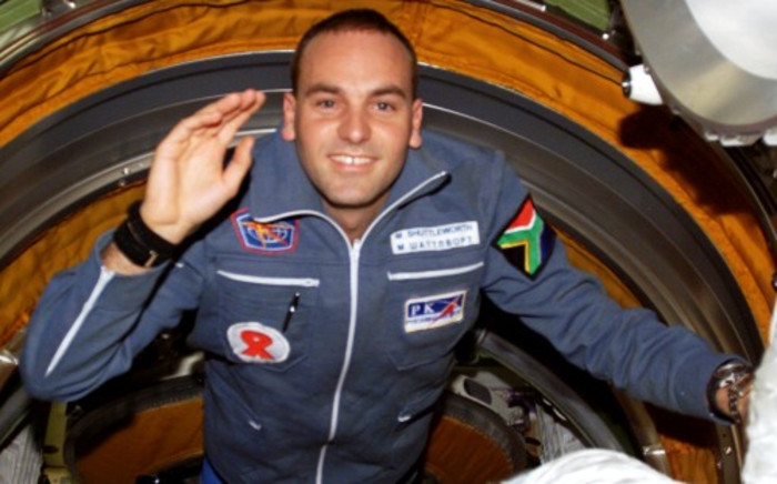 """FILE: Mark Shuttleworth enters the """"functional cargo block's pressurised adapter"""" on the International Space Station on 27 April 2002. Picture: Wikimedia Commons"""""""