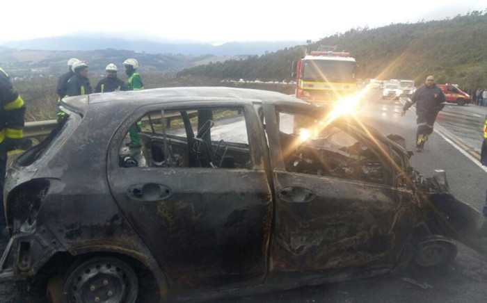 Two vehicles, a taxi and a car, involved in a head-on collision near Sir Lowry's Pass have burnt out. Picture: Western Cape Traffic.