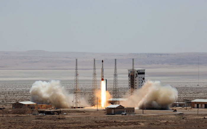 A handout picture released by Iran's Defence Ministry on 27 July 2017 shows a Simorgh (Phoenix) satellite rocket at its launch site at an undisclosed location in Iran. Picture: AFP.