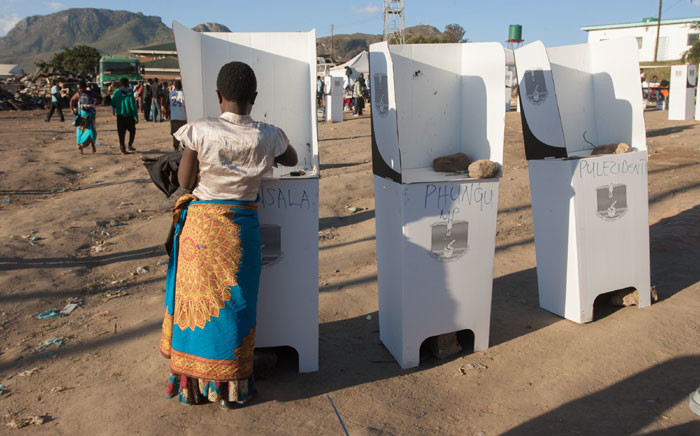 FILE: A woman casts her vote at the Ndirande Community ground polling centre on 21 May 2019 in Blantyre, southern Malawi, during the country general elections. Picture: AFP