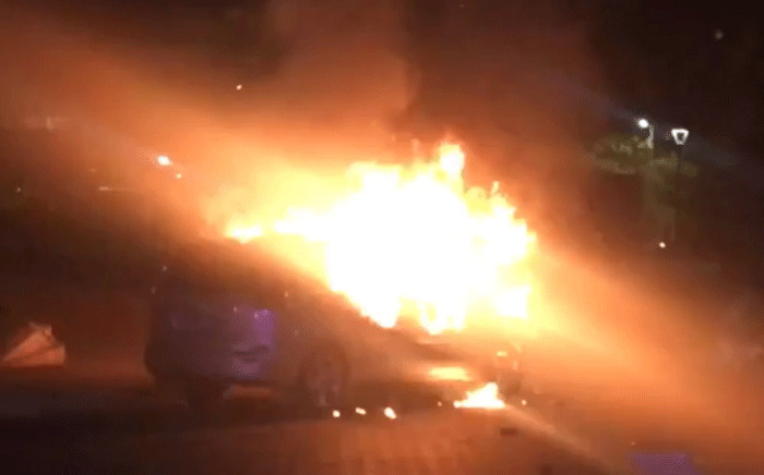 A screengrab shows a car torched during clashes between Uber and meter taxi drivers on 7 September 2017. Picture: EWN