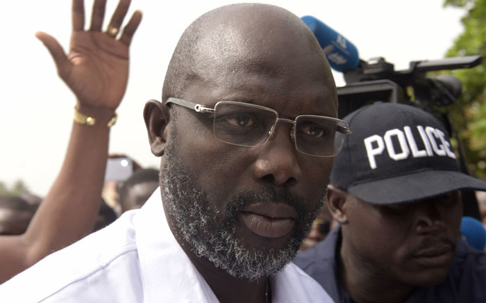 Former footballer George Weah speaks to journalists after casting his ballot for the second round of presidential elections on December 26, 2017 at a polling station in Monrovia. Picture: AFP
