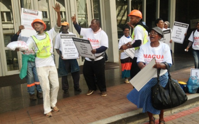 Mining Affected Communities United in Action (Macua) protestors outside the Mining Lekgotla at the Sandton Convention Centre, 27 August 2013. Picture: Govan Whittles/EWN