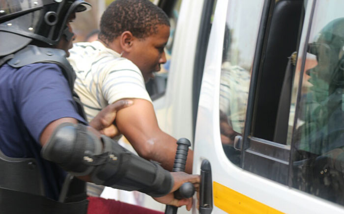 Police arrest one of the students at the University of Limpopo amid Fess Must Fall protests. Picture: Pelane Phakgadi/EWN.