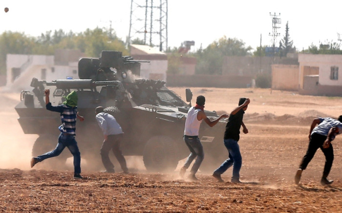 FILE: Turkish Gendarmerie clash with Kurdish demonstrators during a protest against Islamic State (IS) militants near Sanliurfa, Turkey, 07 October 2014. Picture: EPA/SEDAT SUNA.