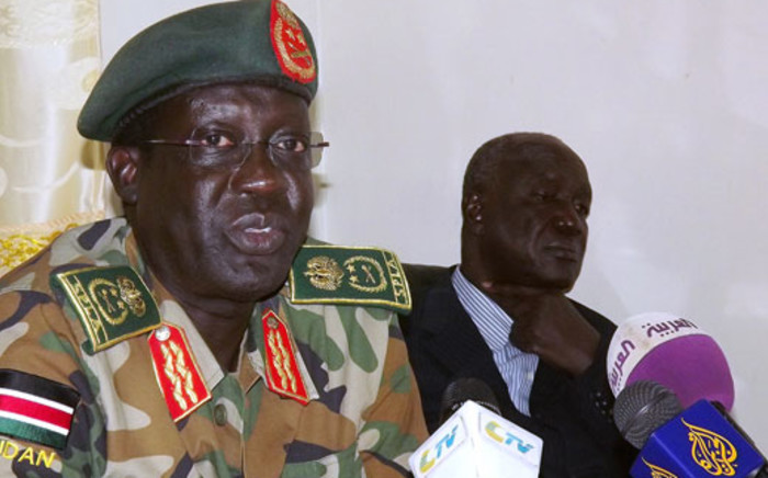 The Sudan People's Liberation Army (SPLA) Chief of Staff General James Hoth Mai speaks to the media in Juba on January 2, 2014 as South Sudan's warring parties prepare for peace talks in Ethiopia. Picture: AFP.
