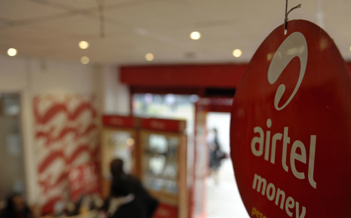 FILE: A sign advertises an 'Airtel' product in a shop on 20 May 2011 in the Kenyan capital, Nairobi. Picture: AFP