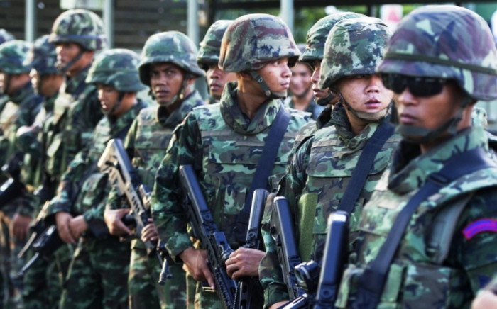 Thai soldiers stand guard after army chief General Prayut Chan-O-Cha announced to the nation that the armed forces were seizing power. Picture: AFP.