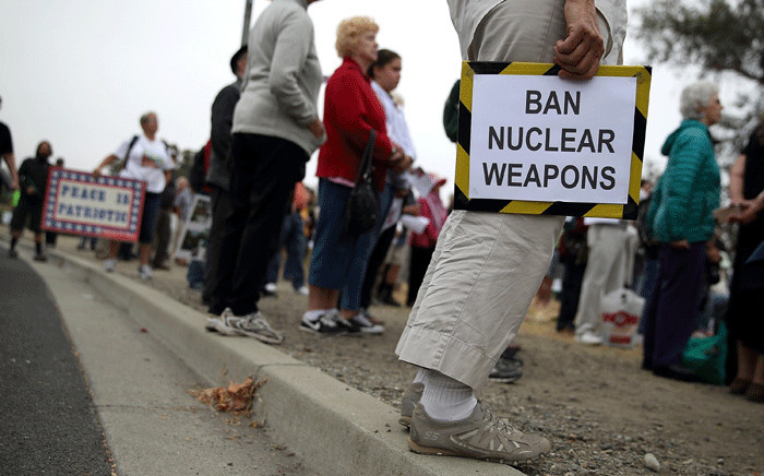 Protesters holds signs during a demonstration against nuclear weapons outside of the Lawrence Livermore National Laboratory on 9 August 2017 in Livermore, California. Picture: AFP.