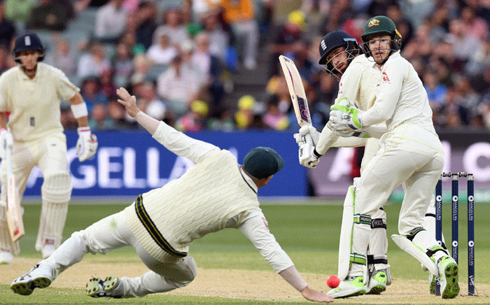 England's batsman James Vince (2nd R) glides a ball past Australia's fieldsman David Warner (2nd L), as England's batsman Joe Root (L) and Australia's wicketkeeper Tim Paine (R) watch, on the fourth day of the second Ashes cricket Test match in Adelaide in 5 December 2017. Picture: AFP.