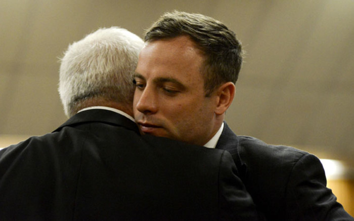 Oscar Pistorius greets his father Henke at the High Court in Pretoria on 21 October 2014. Picture: Pool.