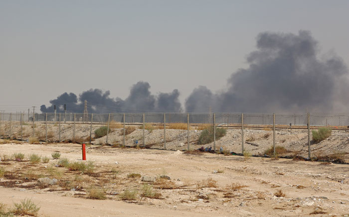 Smoke billows from an Aramco oil facility in Abqaiq about 60km (37 miles) southwest of Dhahran in Saudi Arabia's eastern province on 14 September 2019. Drone attacks sparked fires at two Saudi Aramco oil facilities, the interior ministry said, in the latest assault on the state-owned energy giant as it prepares for a much-anticipated stock listing. Picture: AFP