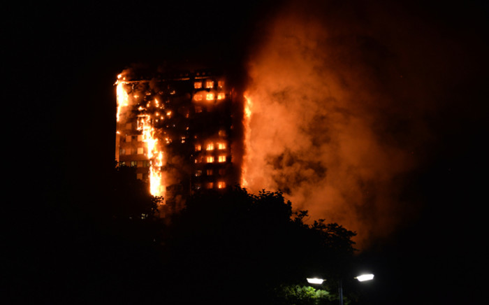 This handout image received by local resident Giulio Thuburn early on June 14, 2017 shows flames engulfing a 27-storey block of flats in west London. Picture: AFP