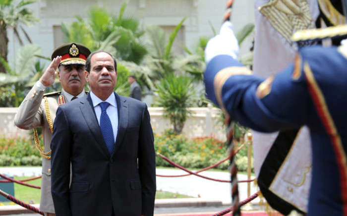 Egypt's President Abdel Fattah al-Sisi reviewing the honour guard during the handing over of power ceremony in Cairo on 8 June 2014. Picture: AFP.
