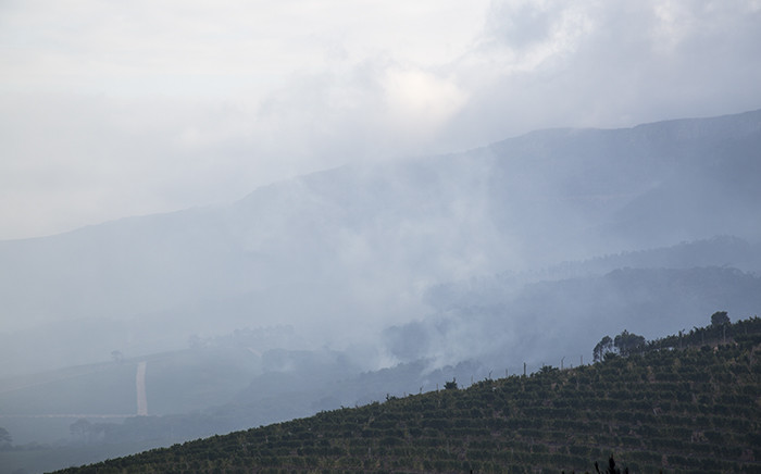 FILE: Smoke rises from the hillsides of the Constantia valley after the March 2015 fire swept through the area around the Groot Constantia wine estate. Picture: Aletta Gardner/EWN
