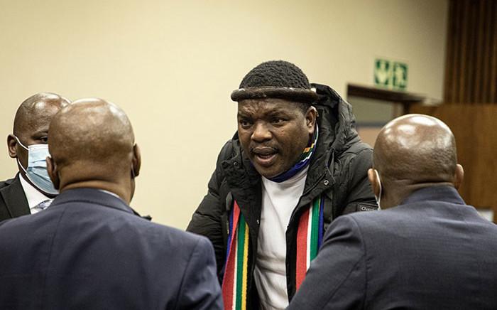 Ngizwe Mchunu consults his lawyers at the Randburg Magistrates Court on 28 July 2021. Picture: Xanderleigh Dookey Makhaza/Eyewitness News