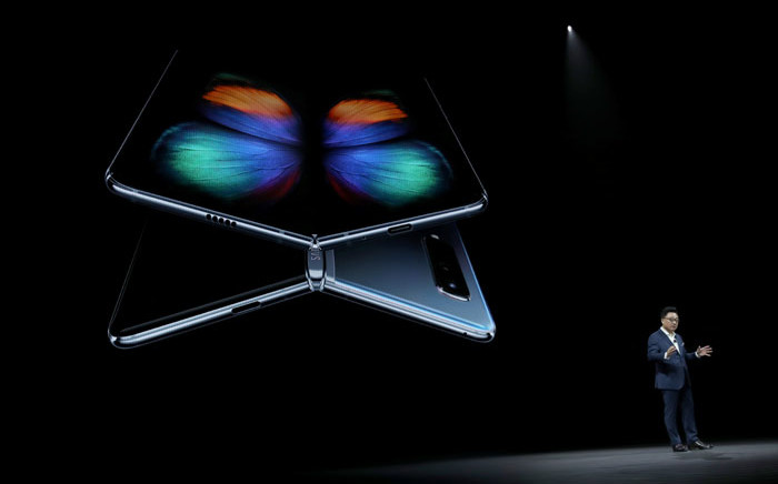 DJ Koh, President and CEO of IT & Mobile Communications Division of Samsung Electronics, announces the new Samsung Galaxy Fold smartphone during the Samsung Unpacked event on 20 February 2019 in San Francisco, California. Picture: AFP