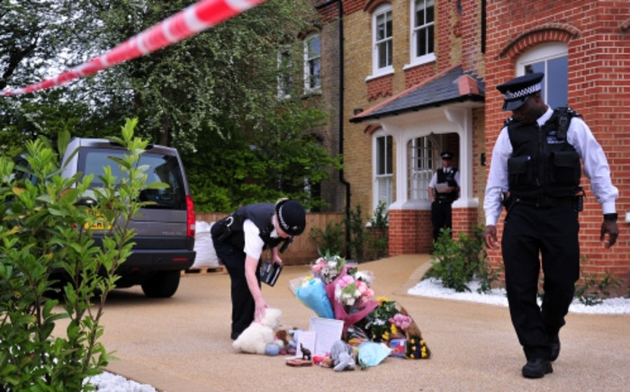 FILE: Officers outside a house in New Malden, south London on 23 April 2014 after three children were found dead at the house on the previous day. Picture: AFP.