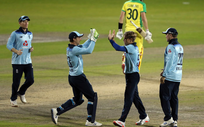 England's Sam Curran celebrates dismissing Australia's Pat Cummins during the one-day international (ODI) cricket match between England and Australia at Old Trafford in Manchester on 13 September 2020. Picture: AFP