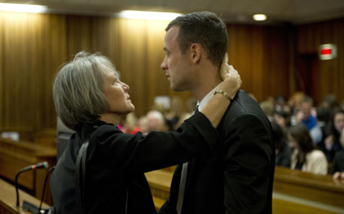 Oscar Pistorius with a family member at the High Court in Pretoria on 7 April 2014. Picture: Pool.