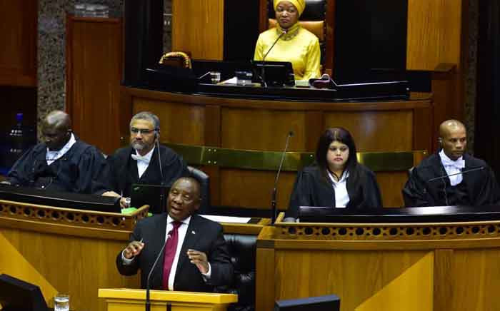 President Cyril Ramaphosa addresses parliamentarians during a Q&A Session in Parliament on 22 August. Picture: @PresidencyZA/Twitter.