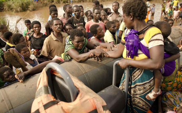 People affected by the Malawi floods boarding a rescue boat. Picture: Twitter @MalawiUNICEF.