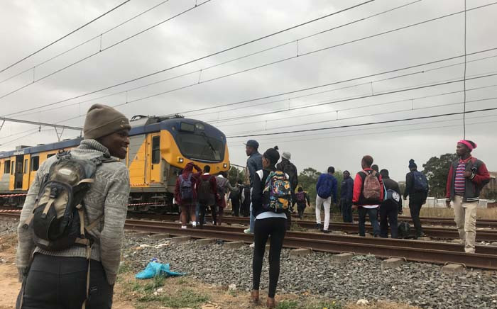 FILE: Commuters outside a train in Philippi after a man was electrocuted, prompting delays in Metrorail train services in the area. Picture: Kaylynn Palm/EWN