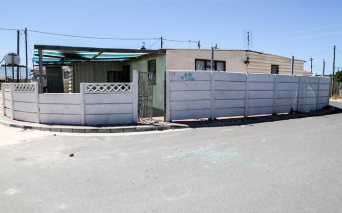 Broken glass lies strewn on the ground in front of Andile Lili's house in Makhaza, Khayelitsha after the controversial activist was shot while sitting in his car on 5 November 2014. Picture: Thomas Holder/EWN.