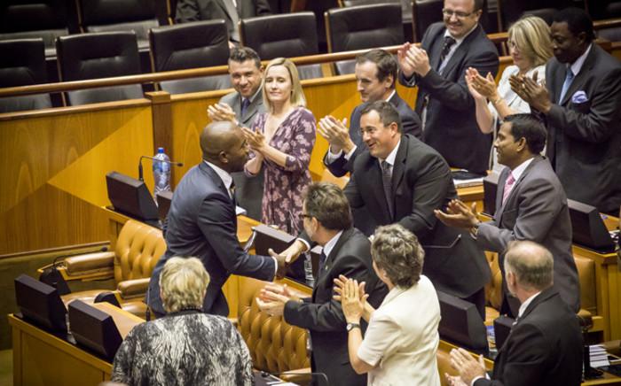 DA MPs congratulate their Parliamentary leader Mmusi Maimane on his 'broken man, broken country' speech during the Sona 2015 debate. Picture: Thomas Holder/EWN.