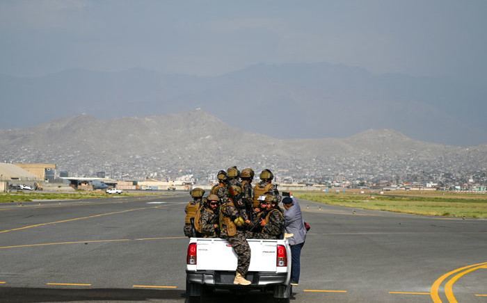 Members of the Taliban Badri 313 military unit ride a vehicle on the runway of the airport in Kabul on 31 August 2021, after the US has pulled all its troops out of the country to end a brutal 20-year war - one that started and ended with the hardline Islamist in power. Picture: Wakil Kohsar/AFP