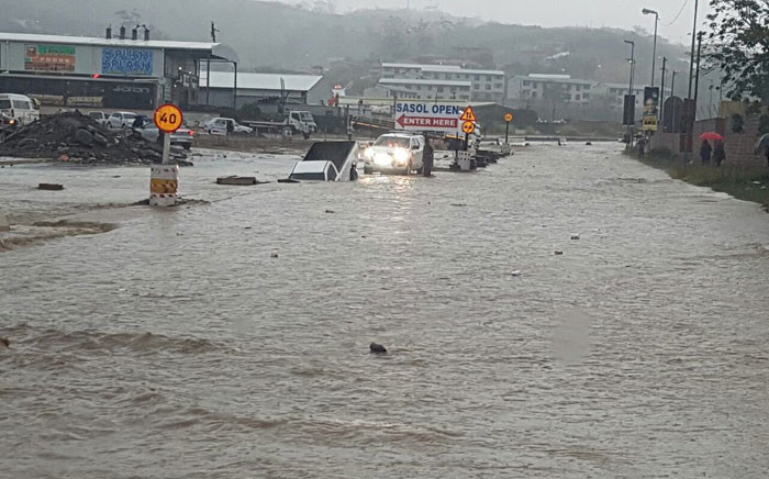 Booth Road in KwaZulu-Natal was flooded following heavy rainfall in the region. Picture: @SAPoliceService via Twitter.