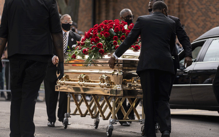 George Floyd's casket is wheeled to a hearse after a memorial service at North Central University on June 4, 2020 in Minneapolis, Minnesota. Rev. Al Sharpton delivered a eulogy for Floyd in front of gathering of his family, politicians and celebrities. Picture: AFP.