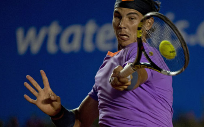 Rafael Nadal of Spain returns the ball to his compatriot David Ferrer during their final Mexico ATP Open men's single tennis match, in Acapulco, Guerrero state on March 2, 2013. Picture: AFP / Yuri Cortez
