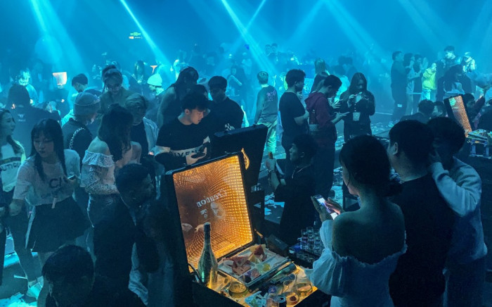 In this picture taken on January 21, 2021, people visit a nightclub in Wuhan, China's central Hubei province. Hector RETAMAL / AFP