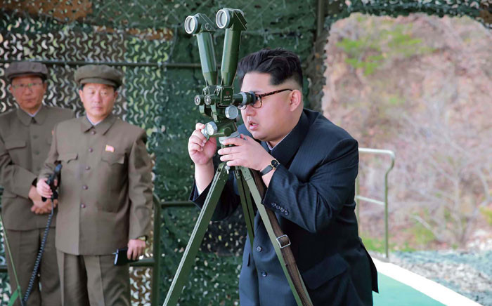 This picture released from North Korea's official Korean Central News Agency (KCNA) on 24 April 2016 shows North Korean leader Kim Jong-Un (R) inspecting an underwater test-fire of a strategic submarine ballistic missile at an undisclosed location in North. Picture: AFP PHOTO/KCNA via KNS.