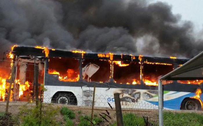 FILE: A bus was set alight near a depot in George during violent protests. Picture: Werner Vermaak ER24.