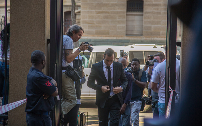 Oscar Pistorius arrives at the high court in Pretoria to set down a date for new sentencing procedures following the murder of his girlfriend Reeva Steenkamp. Picture: Reinart Toerien/EWN.