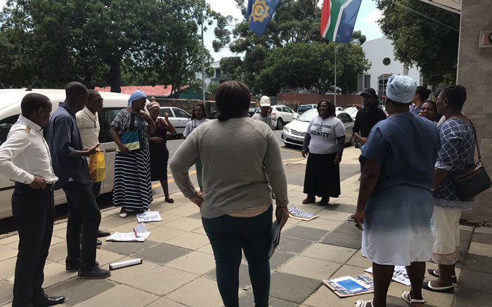 Members of the Social Justice Coalition stage a picket outside the police headquarters in Cape Town on 23 January 2017. Picture: Shamiela Fisher/EWN.