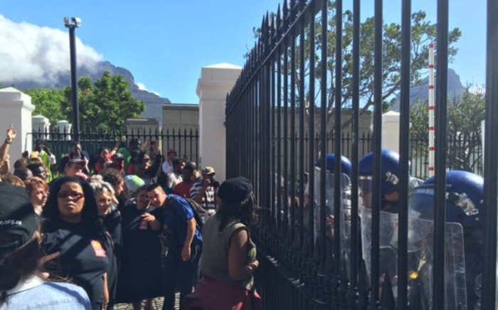 Police have closed the gates to Parliament as university students continue to protest against hikes in tuition fees. Picture: EWN.