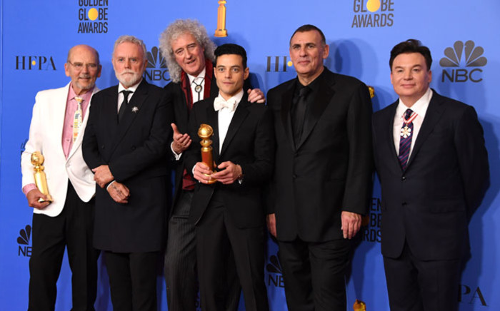 """Best Actor in a Motion Picture – Drama for """"Bohemian Rhapsody"""" winner Rami Malek poses with Graham King (2ndR), Brian May (3rdL) and Mike Myers (R) in the press room during the 76th annual Golden Globe Awards on 6 January 2019, at the Beverly Hilton hotel in Beverly Hills, California. Picture: AFP"""