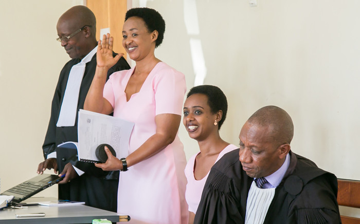 Diane Rwigara (2nd R), a prominent critic of Rwanda's president, and her mother Adeline Rwigara (2nd L), react after their trial was postponed on 24 September 2018, at the hight court of Rwanda in Kigali. Picture: AFP.