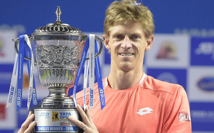 South African tennis player Kevin Anderson poses with the trophy after winning the men's single final match for the Tata Open Maharashtra ATP tennis tournament at the Shree Shiv Chhatrapati Sports Complex Stadium in Pune on 5 January, 2019. Picture: AFP.