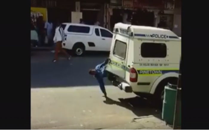 A screengrab showing how one of two men escaped from a parked police van in Pinetown.