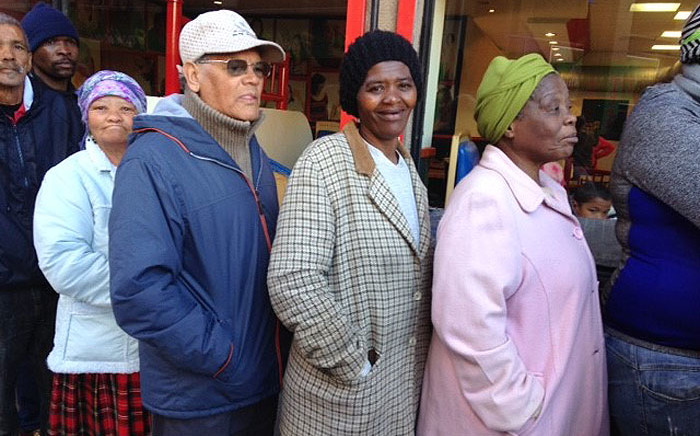 Pensioners stand in line as they wait to withdraw their monthly monies from a Sassa payout point at Shoprite in Mitchells Plain Cape Town. Picture: Lauren Isaacs/EWN