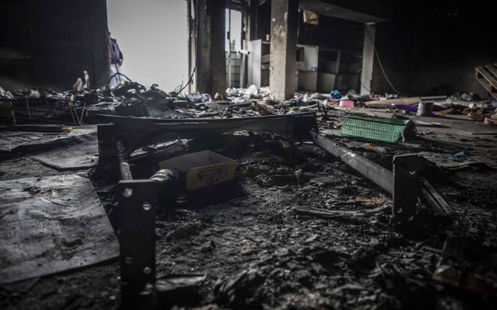 FILE: Asif Raza, business owner in Umkomaas, KwaZulu-Natal lost his supermarket to the week of violence and looting. Picture: Abigail Javier/Eyewitness News
