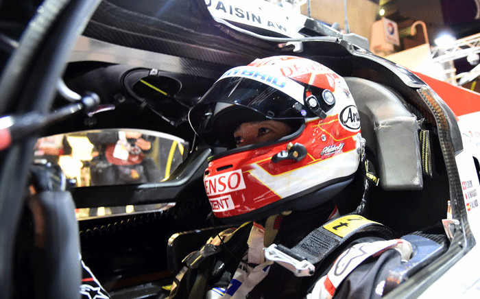 Japanese driver Kazuki Nakajima waits in his Toyota TS050 Hybrid LMP1 during the qualifying practice session of the 86th edition of the 24 Hours of Le Mans endurance race, on 13 June 2018, at the Le Mans circuit, northwestern France. Picture: AFP