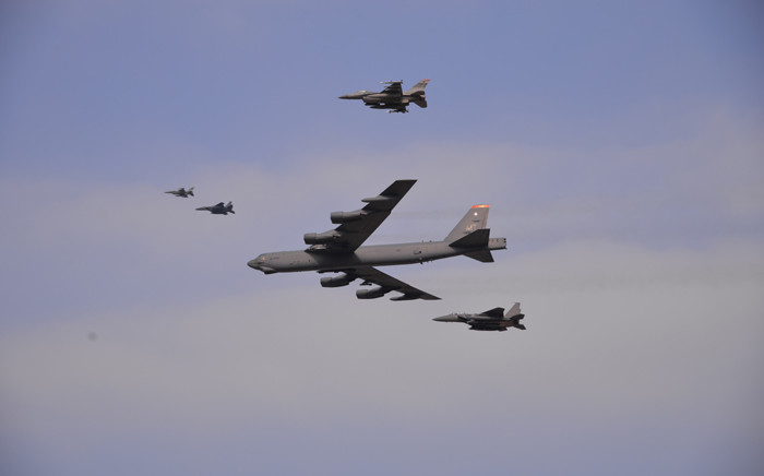 FILE: In this January 2016 US Air Force handout photo, a US Air Force B-52 Stratofortress from Andersen Air Force Base, Guam, conducts a low-level flight in the vicinity of Osan Air Base, South Korea, in response to provocative action by North Korea. Picture: AFP.
