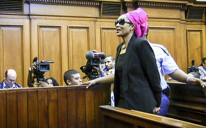 FILE: Convicted murderer Thandi Maqubela is handcuffed after sentencing and momentarily stops to mouth a few words to her family in the gallery in the High Court. Picture: Thomas Holder/EWN