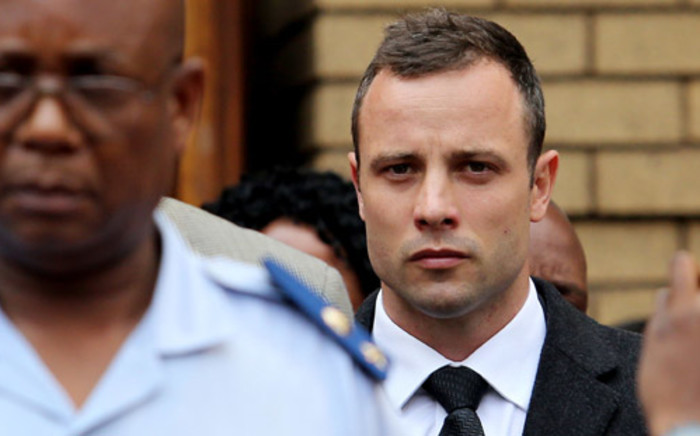 Oscar Pistorius leaves the High Court in Pretoria after day five of his murder trial on 7 March 2014. Picture: Sebabatso Mosamo/EWN.
