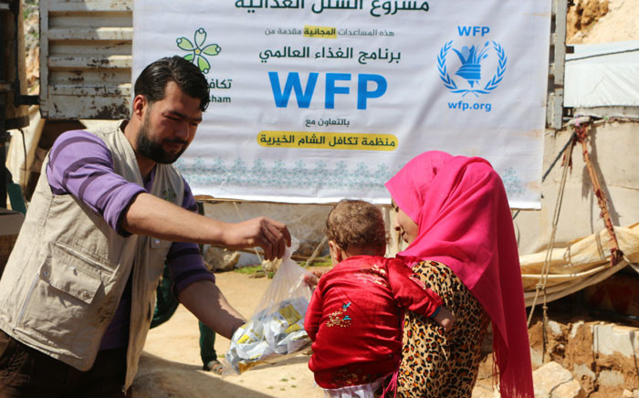 FILE: UN World Food Programme workers hand out food in Syria. Picture: @WFP_Syria/Twitter